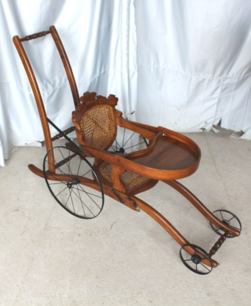 Antique Victorian walnut hi-chair that folds into a stroller from the 1870s