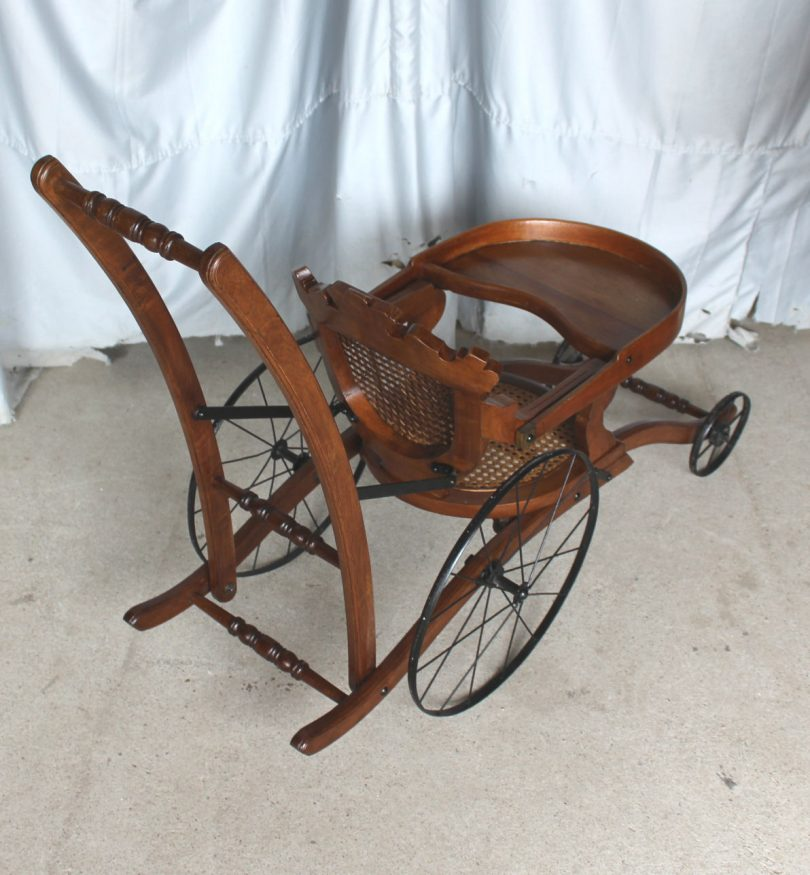 Antique Victorian walnut high chair that folds into a stroller from the 1870s