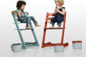 two-wooden-colorful-high-chairs-with-twins-sitting-on